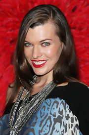 Milla loves to play with jewels and with her more is more. She added a ton of neck candy to her leopard print blue dress. The silver strands called attention to her bright red lips and side-swept hair.