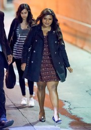 Mindy Kaling made her way to 'Kimmel' wearing a black trenchcoat over a mini dress.