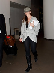 Minka Kelly enveloped herself in a nubby gray duster at the airport.