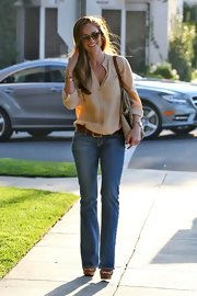 Minka Kelly added '70s glamor to her street style with a pair of light belted flares.
