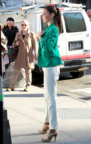 Miranda Kerr was spotted on set with a bright blazer and platform sandals with buckled detailing.
