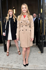 Jennifer looks classy at the Miu Miu fashion show in Paris wearing a classic camel trench.