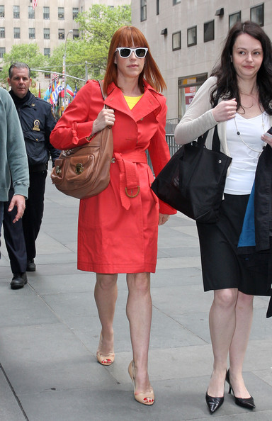Molly Ringwald looked so striking in her chic orange trenchcoat.