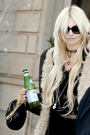 Taylor Momsen carried a black leather bag while hitting Paris. The bag featured a gold chain strap.