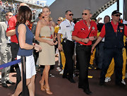 Charlene Wittstock wore a tan strapless day dress accessorized with a slim leather belt and strappy sandals.