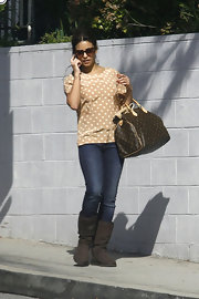 Monica Cruz went for a walk carrying a luxe monogrammed Louis Vuitton tote.