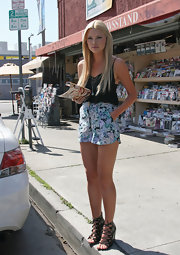 Sophie wore strappy, lace-up wedges with floral pirnt shorts and a black cami.
