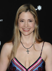 Mira Sorvino kept her accessories to a minimum, wearing only this cross pendant necklace.