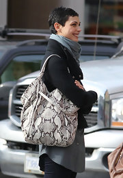 Morena showed off her casual side in a cute  grey scarf, which she paired with a snakeskin shoulder bag.