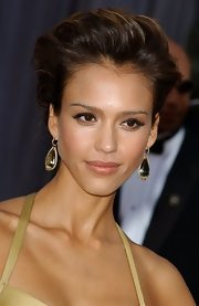 Jessica Alba paired her elegant updo with crystal and gold dangle earrings.