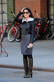 Olivia Munn hailed a cab in slouchy taupe leather knee high boots.