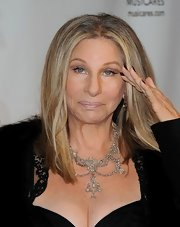 Barbra Streisand wore her hair in a simple center-parted style for the MusiCares 2011 tribute.