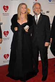 Barbra Streisand was every bit the diva in this luxurious black evening coat layered over an elegant gown at the MusiCares 2011 tribute.