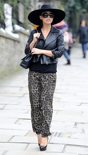 Myleene Klass opted for a cropped leather jacket to pair with her leopard print pants for a cool and chic street look.