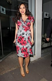 Myleene Klass paired her feminine floral print wrap dress with nude platform pumps.