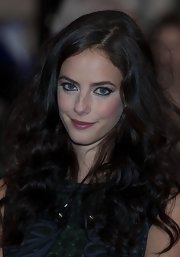 Kaya Scodelario left her thick curls loose for her 'Now is Good' red carpet look.