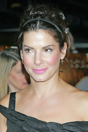 Sandra Bullock wears a double headband in her hair for added interest at the NYC 'Infamous' premiere.