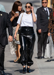 Naomi Scott rounded out her attire with black booties by Jimmy Choo.