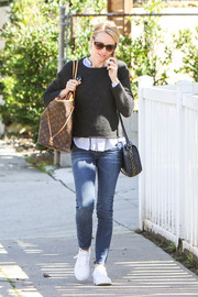 Naomi Watts layered a black sweater over a blue shirt for a stroll in LA.