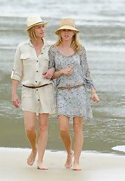 Naomi Watts wore a sweet sun hat with her floral dress while out filming on the beach.