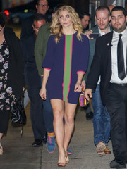 Natalie Dormer colored up her look in a long-sleeved purple shift dress with green and pink piping while making her way to 'Jimmy Kimmel Live'.