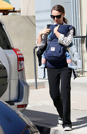 A relaxed Natalie Portman paired a polka-dotted blouse with cozy black sweats while running errands with her son.
