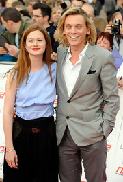 Jamie Campbell Bower looked debonair in his gray blazer and white shirt.
