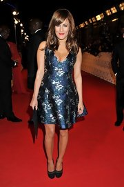 Caroline attended the NTA Awards in a lovely '50s-inspired dress with an unusual metallic pattern.