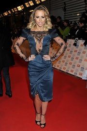 Kimberley Walsh paired black ankle-strap peep-toes with a sultry dress for her National Television Awards red carpet look.