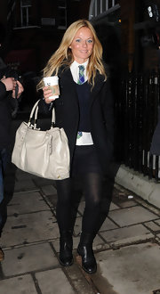 Geri's oversized, nude, leather handbag is classic and  stylish.