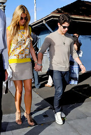 Delta Goodrem chose an airy ensemble, consisting of a nude mini skirt and a print top, for a day out with Nick Jonas.