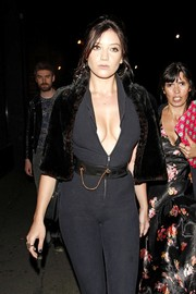 Daisy Lowe paired a chain-embellished belt with a sexy catsuit for Nick Grimshaw's birthday party.