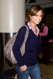 Vanessa goes preppy perfect in a v-neck sweater.