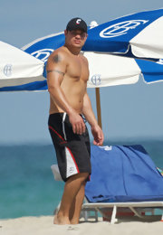 Nick flashed a handful tattoos while walking shirtless on the beach. The singer has a sun tattoo on the upper part of his right arm.