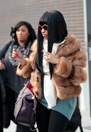 Nicki Minaj kept her look luxe with a glam purple monogram-embossed tote.