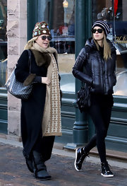 Nicky Hilton opted for an uncharacteristically sport look in Aspen in black patent sneakers.