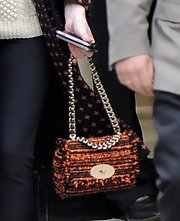 Nicola Roberts added extra texture to her look with this tweed chain strap bag.
