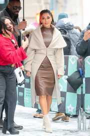 Nicole Scherzinger was edgy-chic in a brown leather dress while visiting the Build Series.