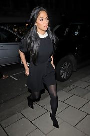 Nicole Scherzinger sported an evening-appropriate romper with pleated shorts and a belt while out in London.