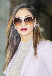 Nicole Scherzinger topped off her look with a pair of angular butterfly sunnies.