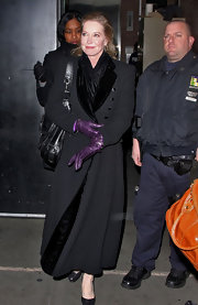 Lisa Niemi kept her winter style elegant in a long black coat with velvet trim.