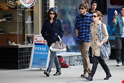 Nikki Reed tries to slip under the radar in a hooded coat, jeans, and flat boots while hanging out in Vancouver with her boyfriend and costar.