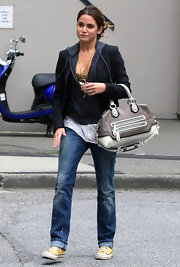 Nikki carries a practical white and grey bowler bag, with two front zips.