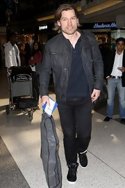 Nikolaj Coster-Waldau chose a modern-style zip up for his casual travel look.