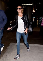 Nina Agdal was spotted at LAX looking biker-chic in a black leather jacket.