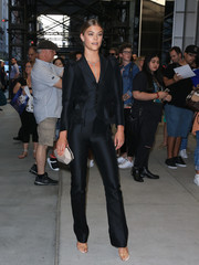 Nina Agdal styled her suit with a faceted taupe clutch by Atelier Swarovski.