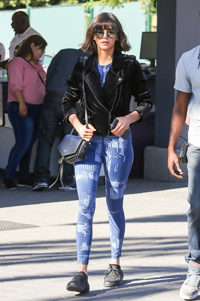 Nina Dobrev sealed off her sporty ensemble with a pair of black sneakers.