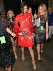 Nina Dobrev was spotted out during New York Fashion Week wearing a swoon-worthy Marchesa dress, in red Chantilly lace with petal-appliqued sleeves.