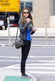 Nina Dobrev kept things casual in a pair of black ankle-length skinny jeans.