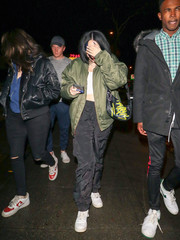 Noah Cyrus was trendy in an army-green bomber jacket while enjoying a night out.
